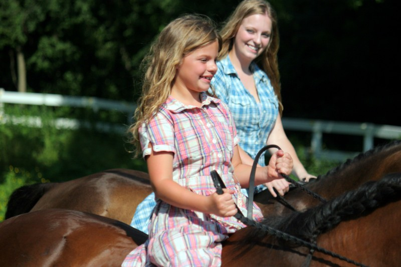 Two girls and two horses
